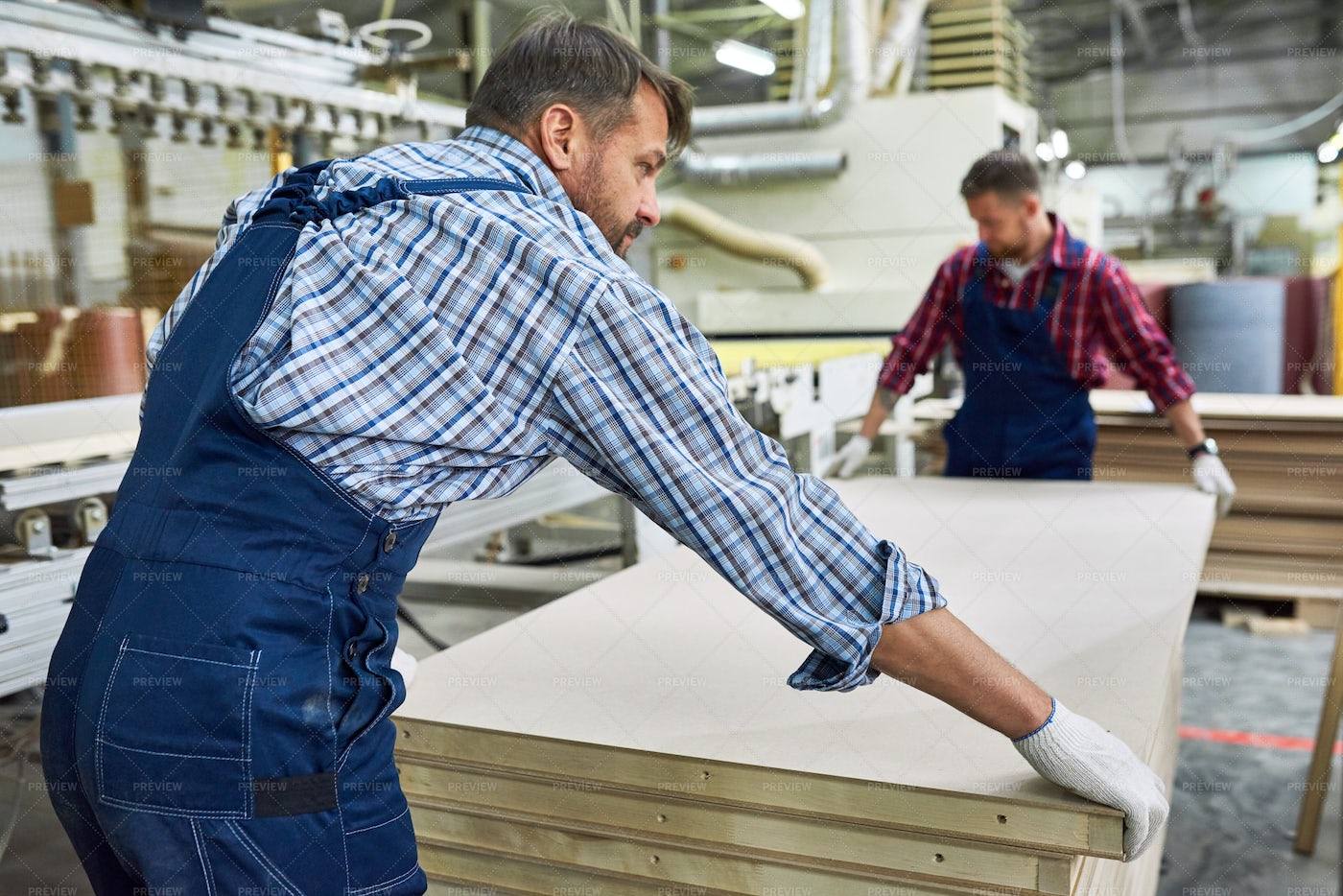 Factory Workers Moving Materials In...: Stock Photos