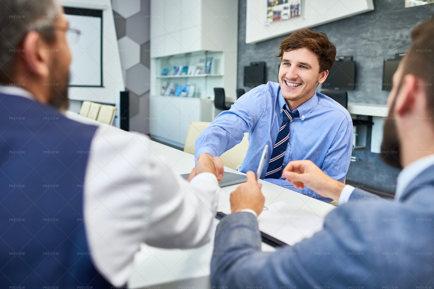 Young Businessman In Greeting...: Stock Photos