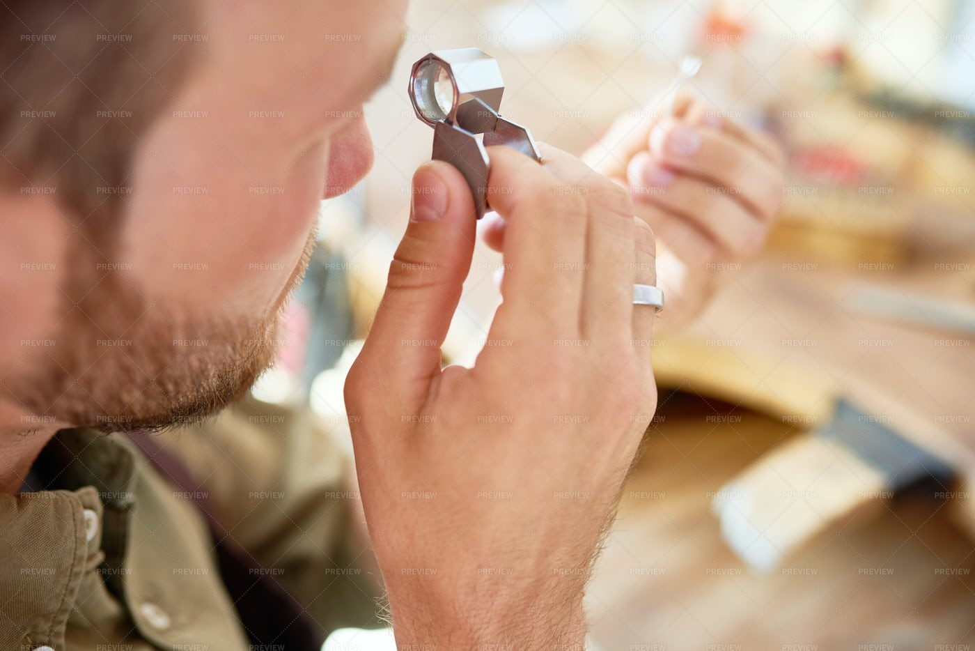 Ring Appraisal In Jewelry Shop: Stock Photos