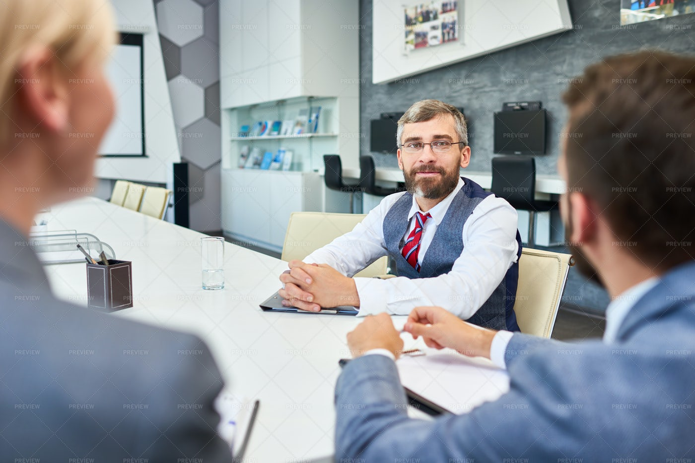 Mature Businessman Listening To...: Stock Photos