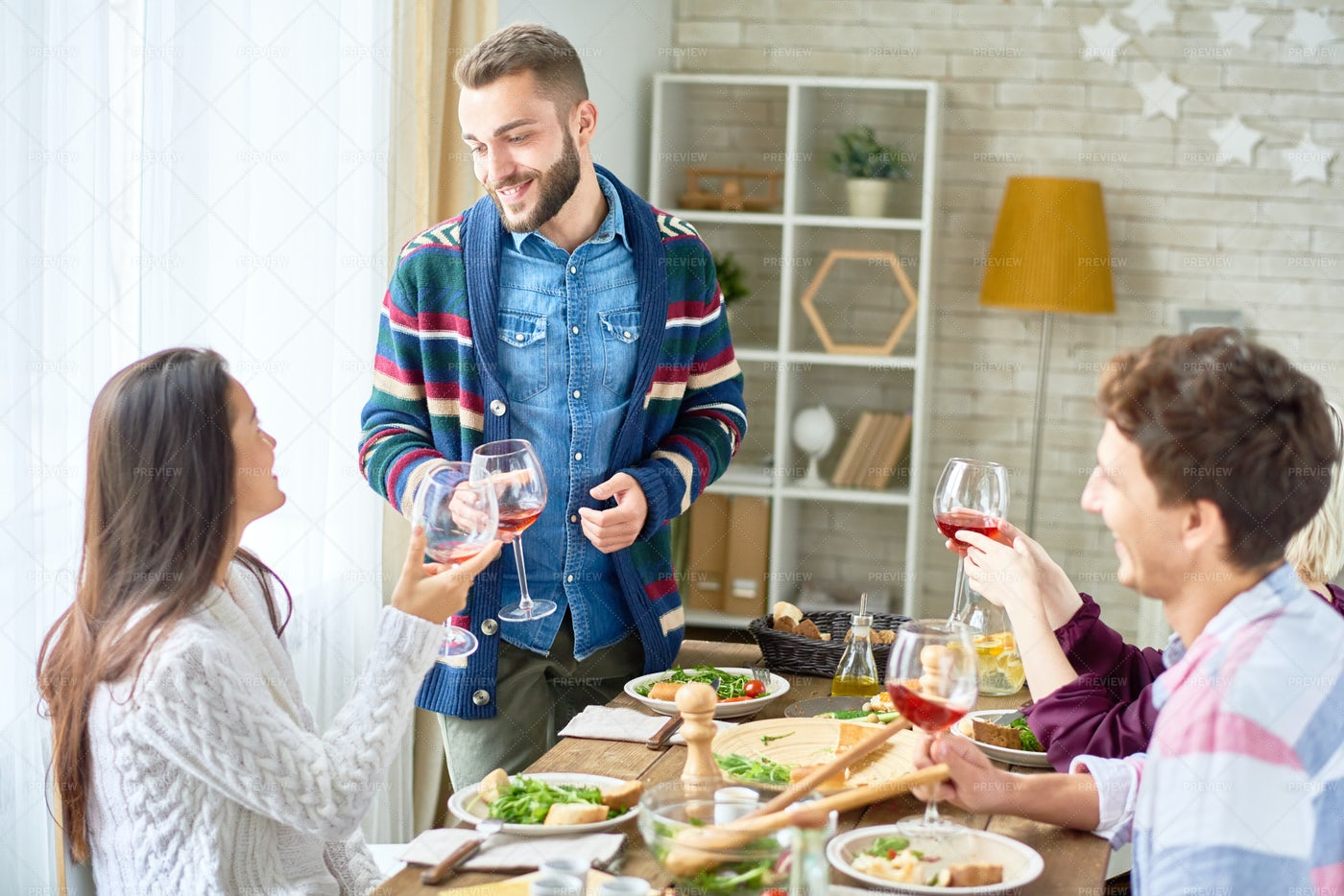 Friends Toasting At  Dinner: Stock Photos