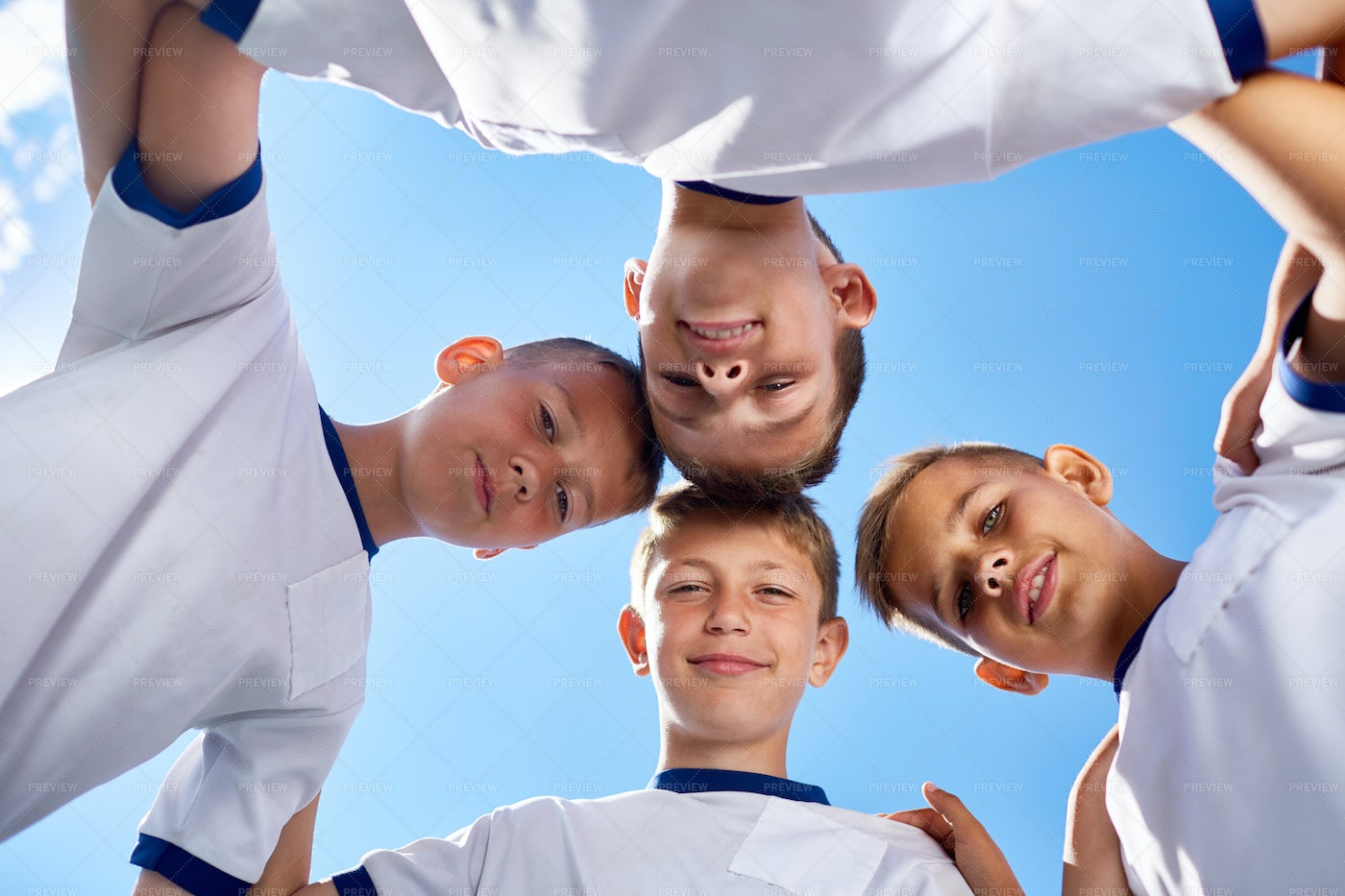 Junior Football Team Huddling: Stock Photos