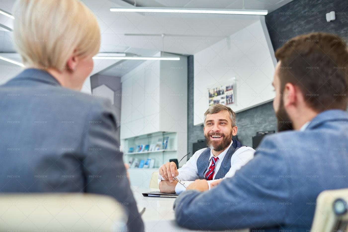 Mature Businessman Talking To...: Stock Photos