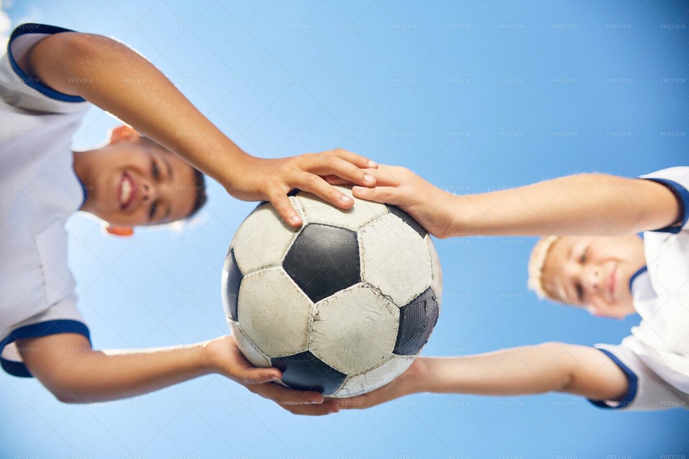 Two Boys Holding Football Ball: Stock Photos