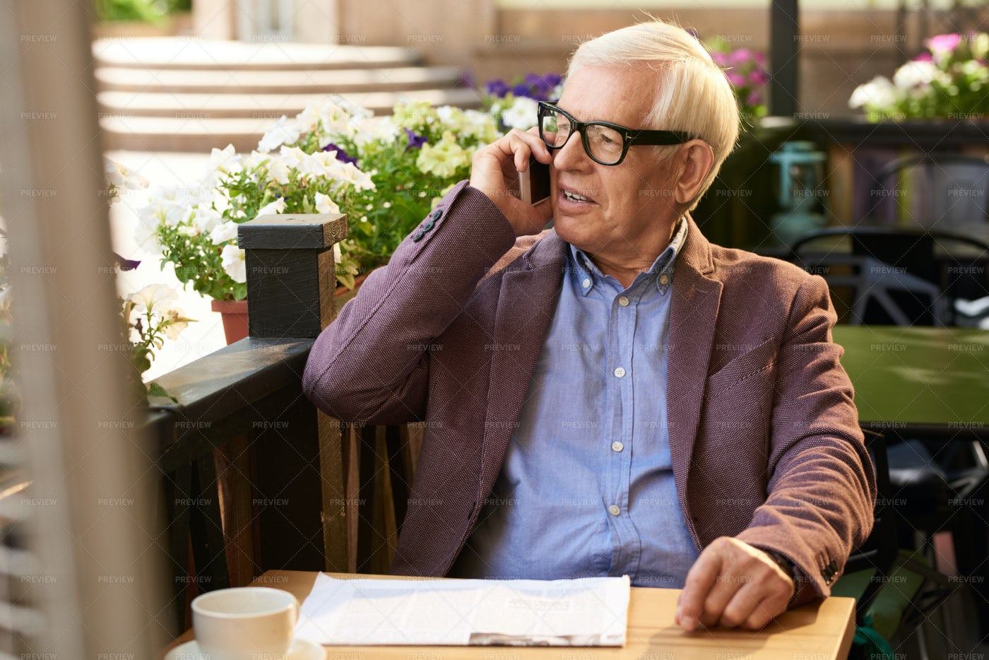 Senior Man Speaking By Phone In...: Stock Photos