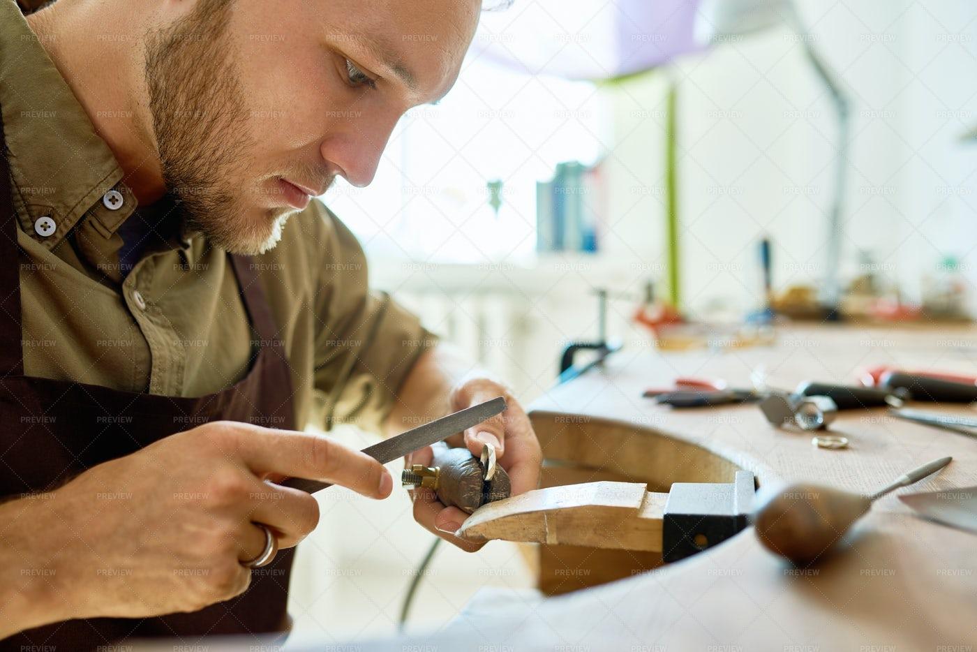 Young Jeweler Making Ring Close Up: Stock Photos