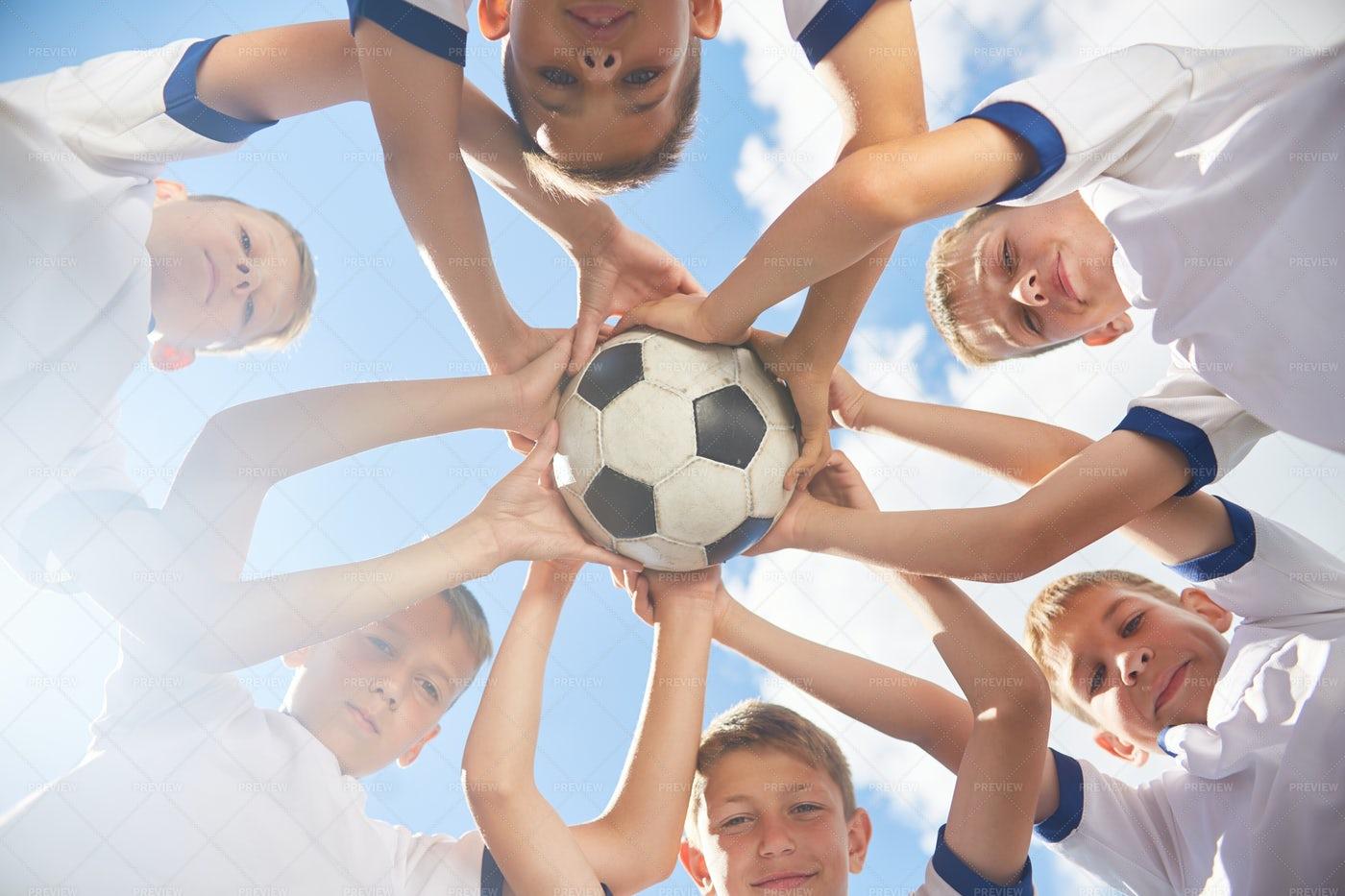 Happy Junior Football Team Holding...: Stock Photos