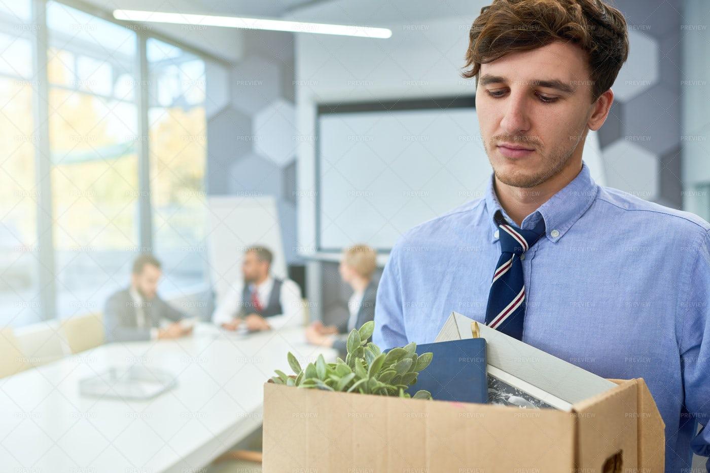 Sad Young Man Leaving Job: Stock Photos