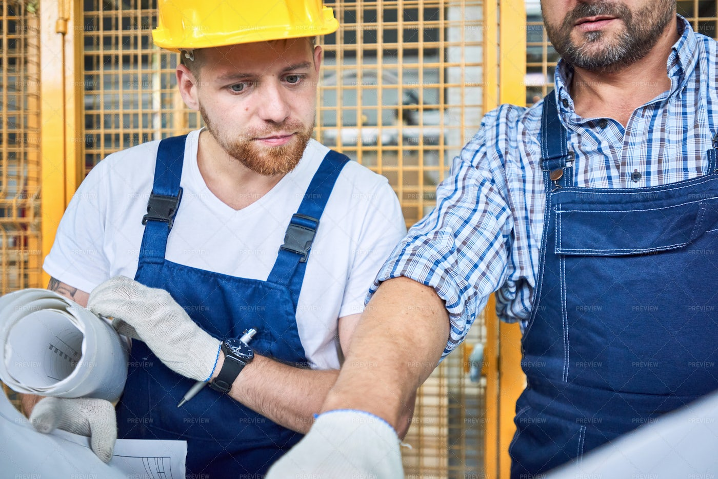 Construction Workers Checking Plans...: Stock Photos