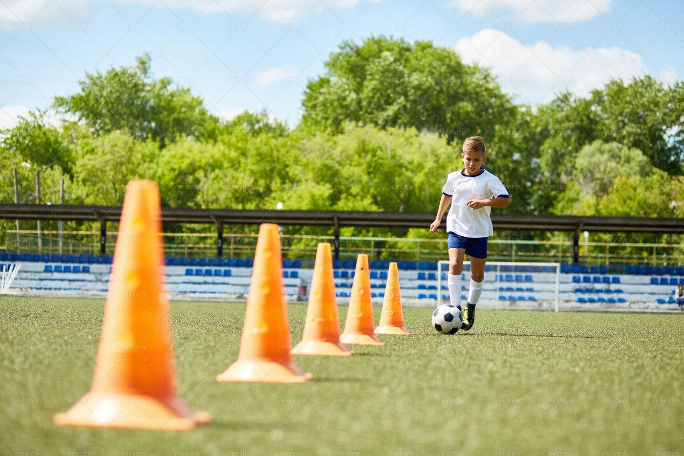 Junior Football Player Practicing...: Stock Photos