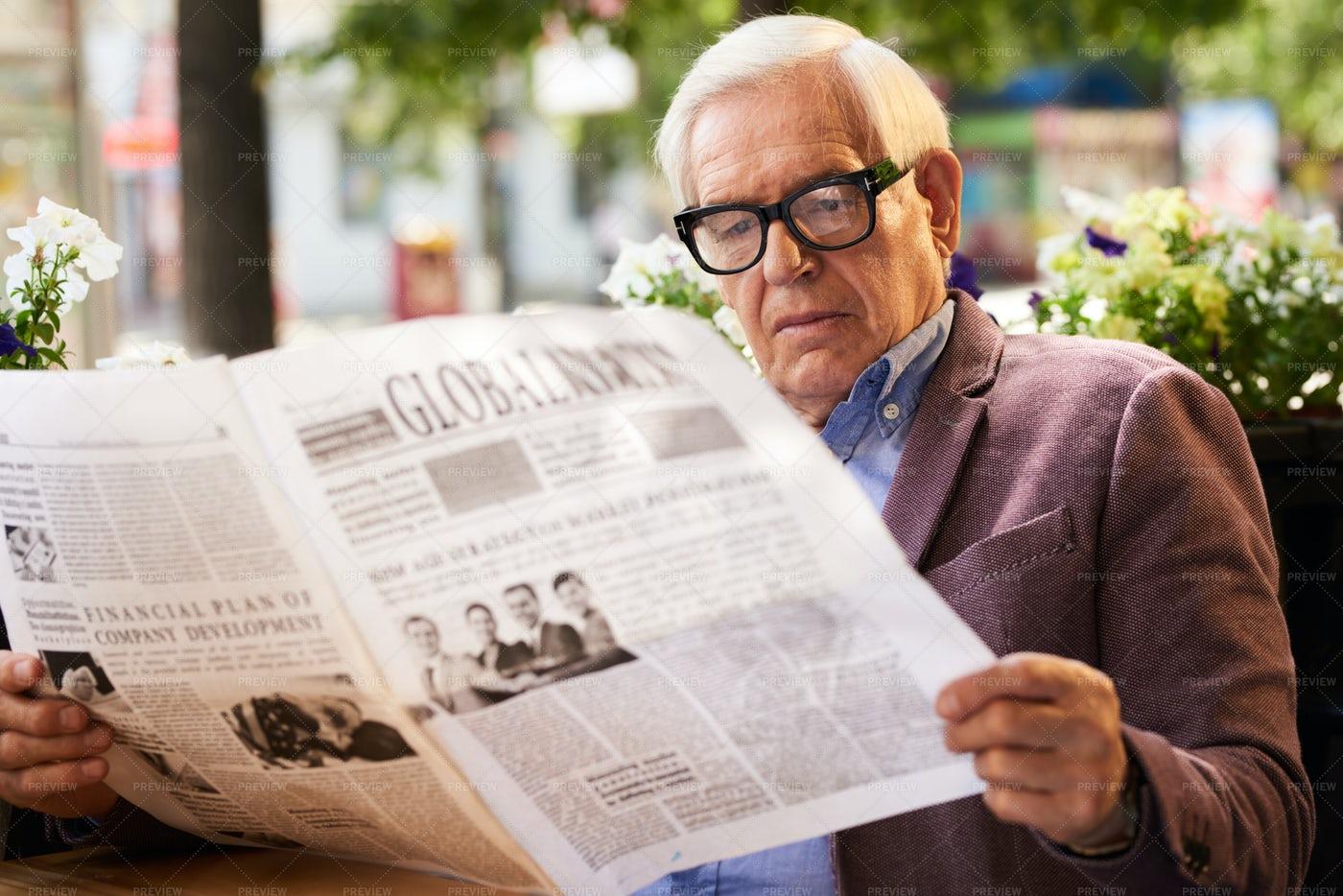 Senior Man Reading Newspaper: Stock Photos