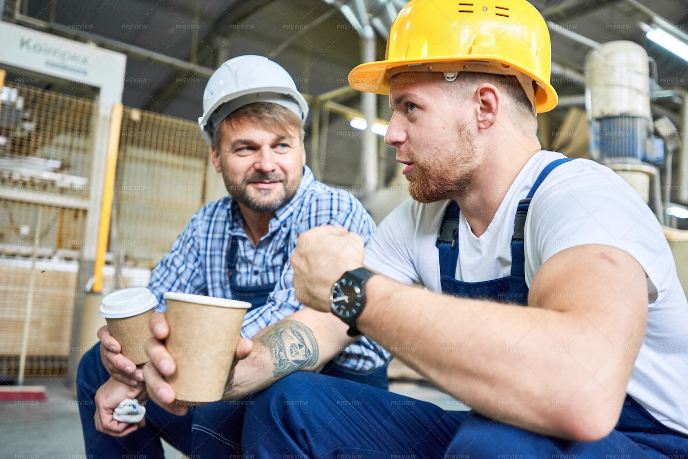Construction Workers Chatting On...: Stock Photos