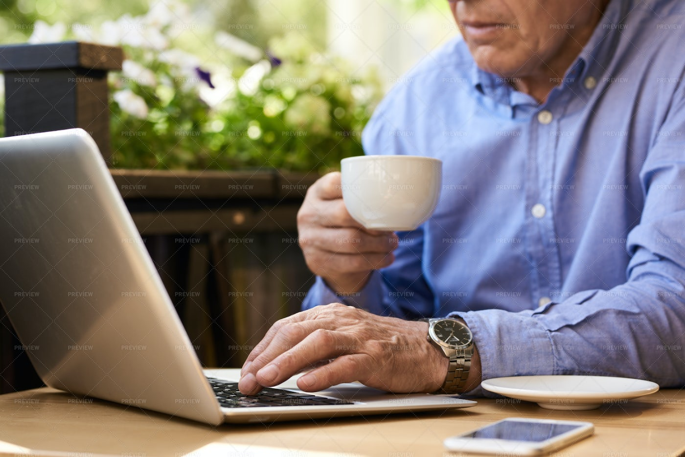 Senior Man Using Laptop During...: Stock Photos