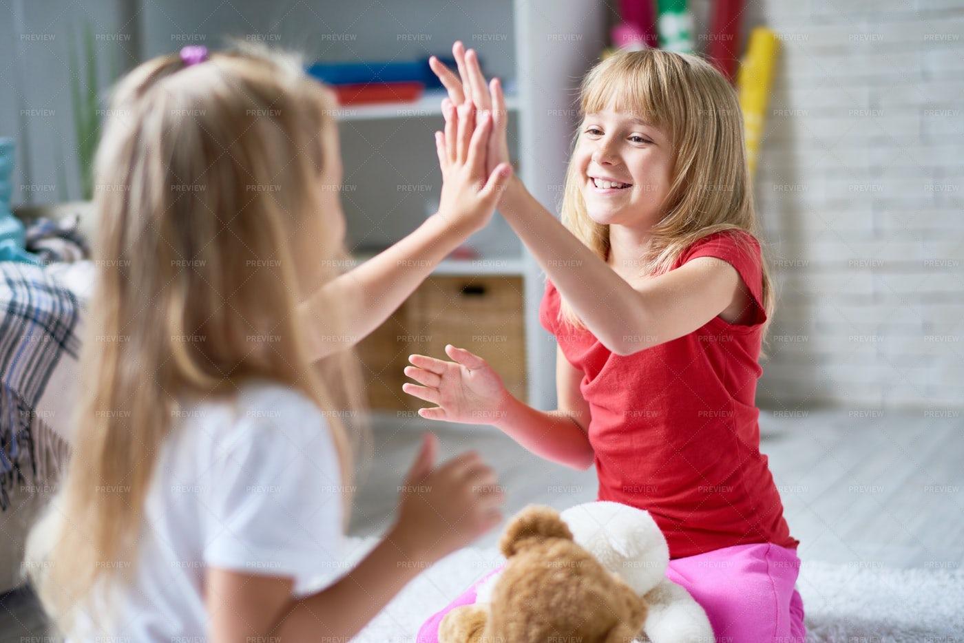 Joyful Little Girls Playing...: Stock Photos