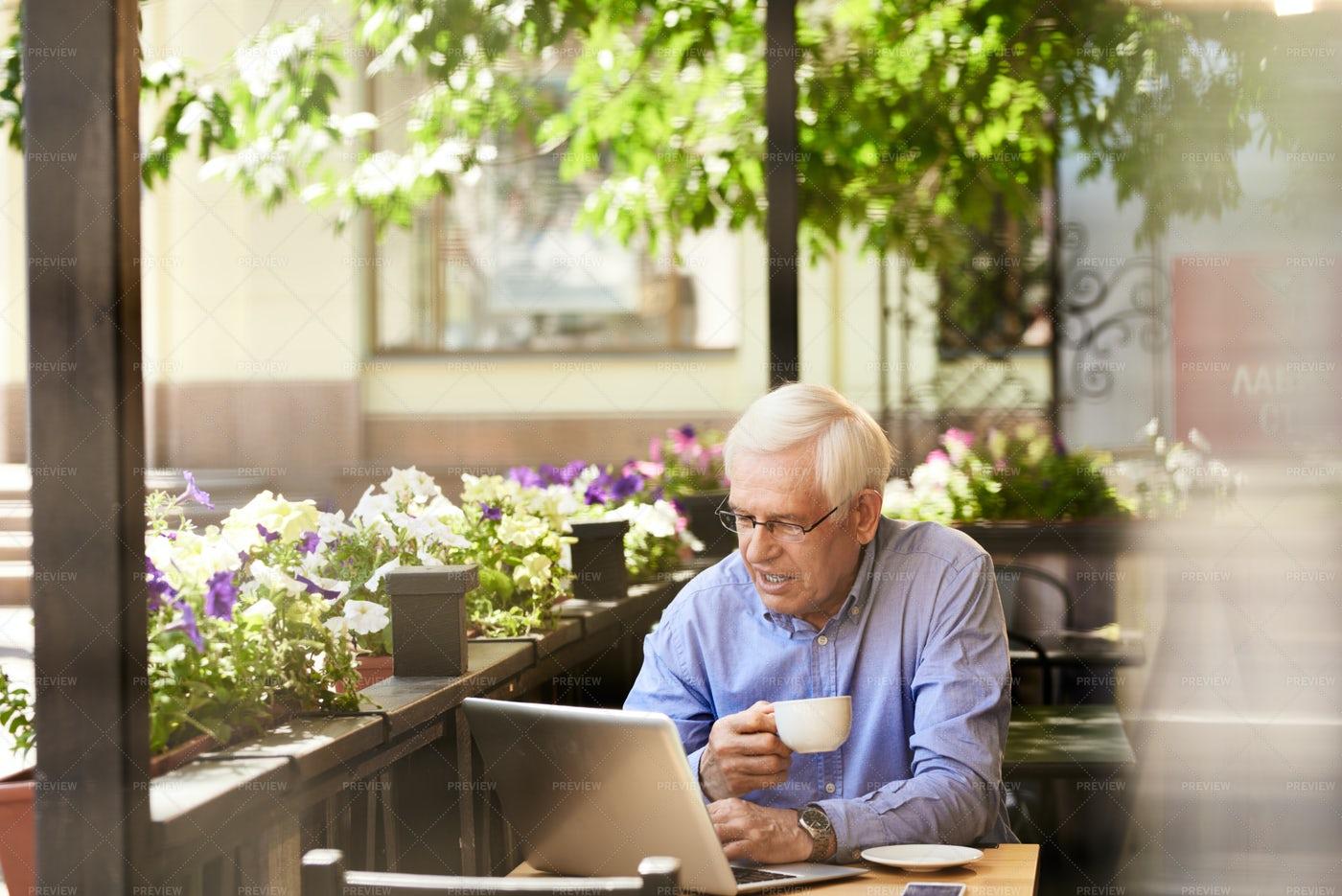 Modern Senior Man Using Laptop In ...: Stock Photos