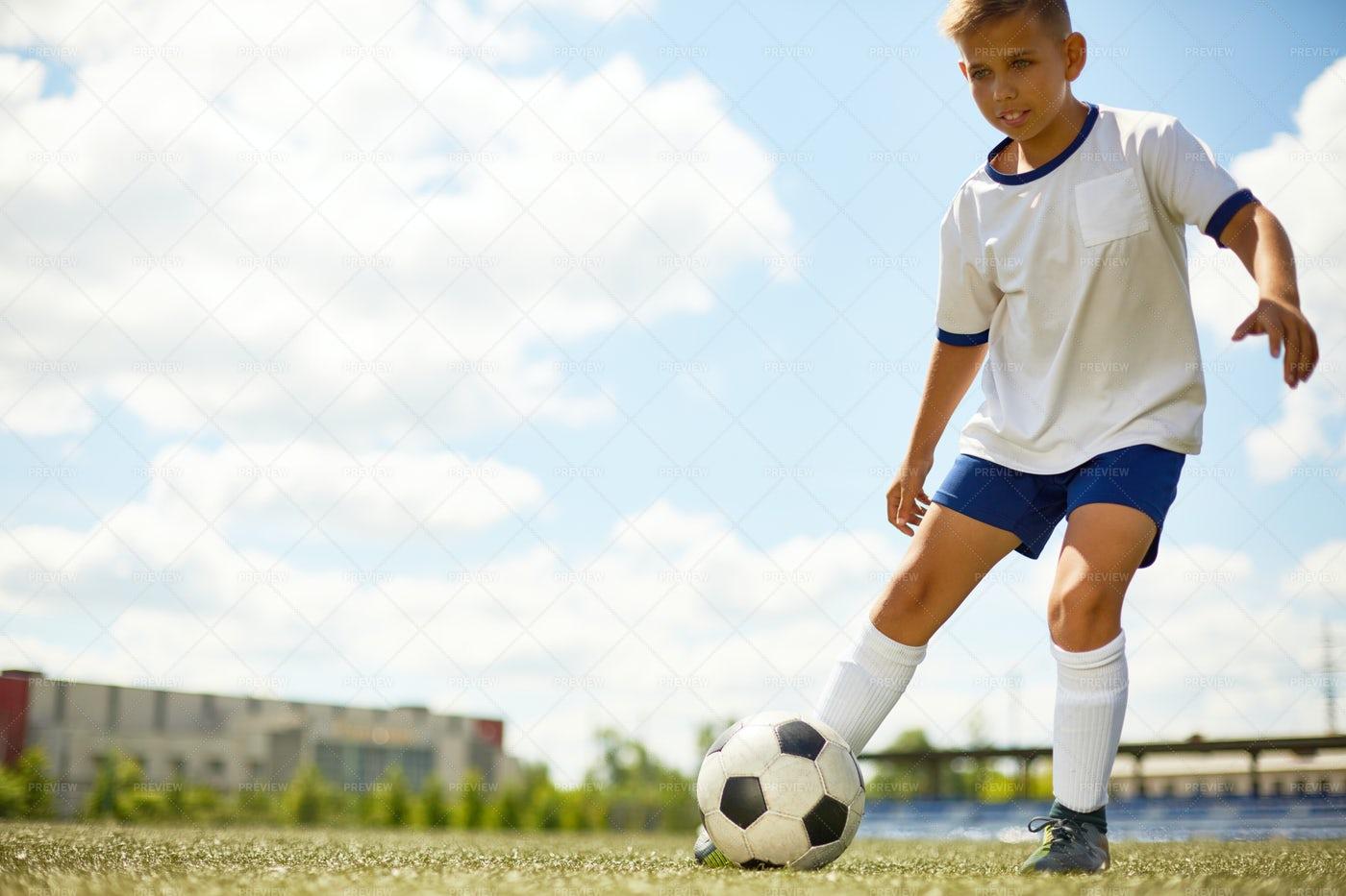 Teenage Boy Playing Football: Stock Photos