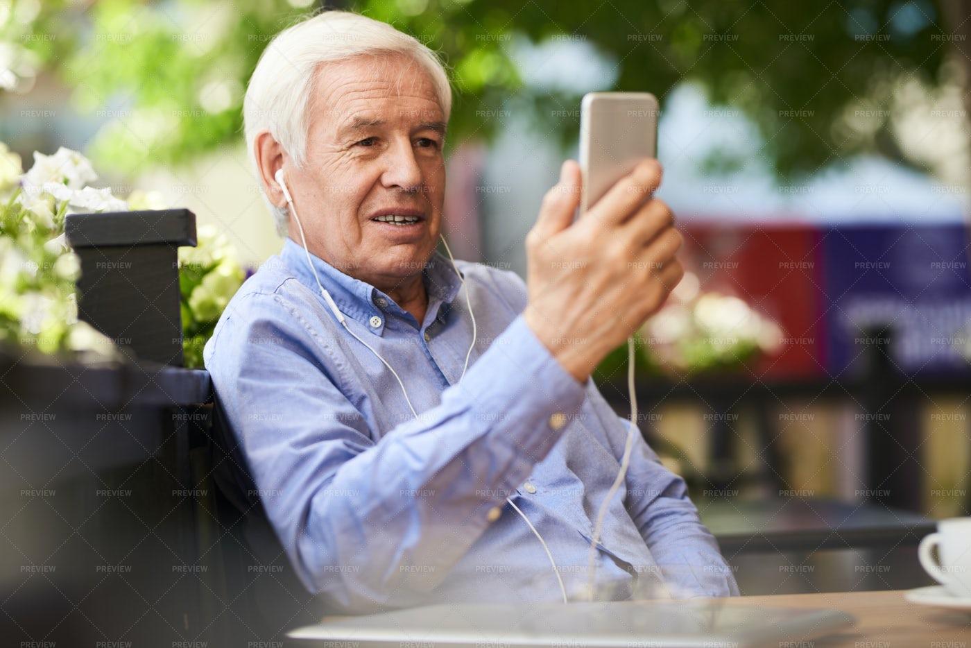 Modern Senior Using Video Call: Stock Photos