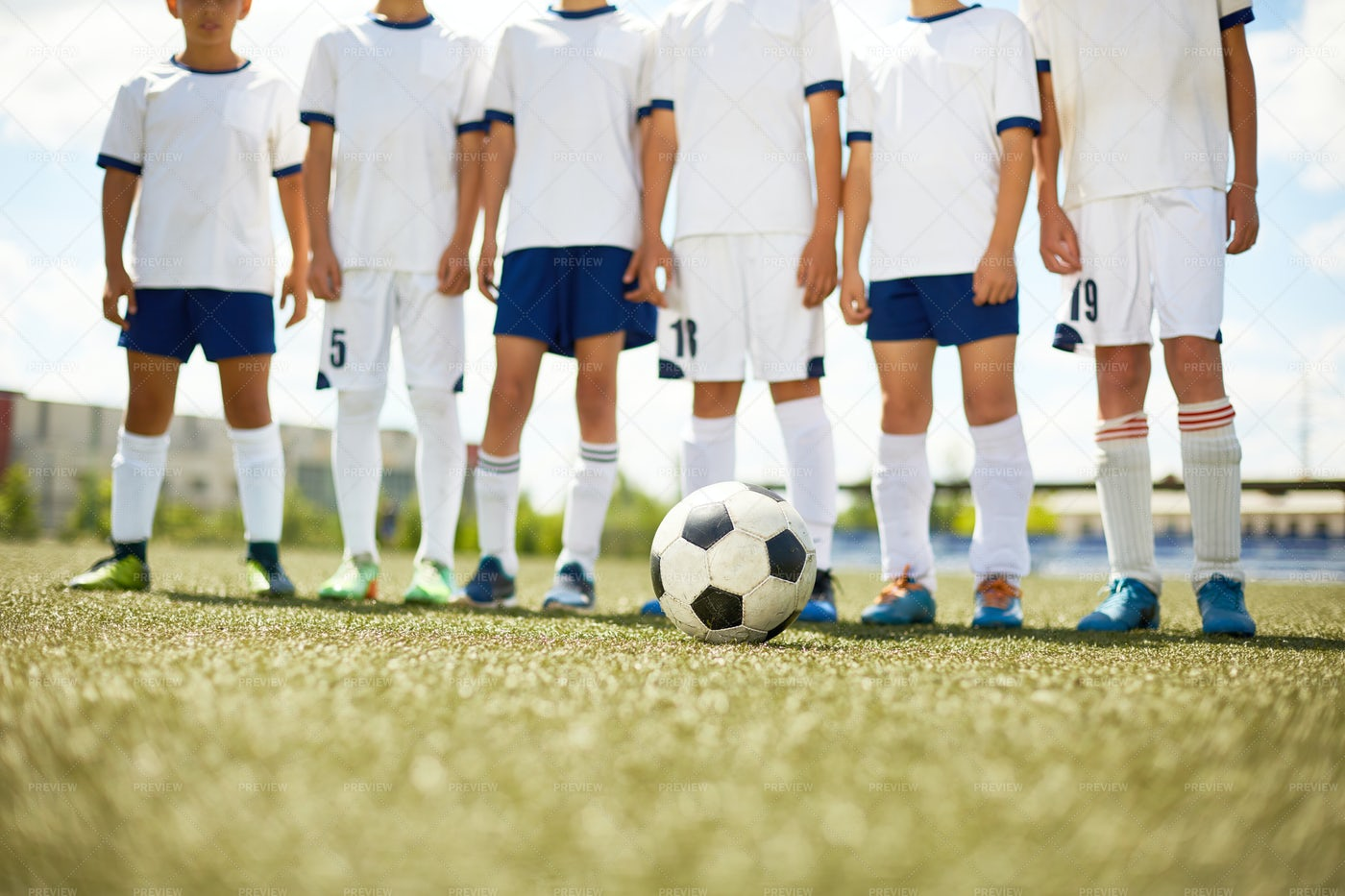 Young Football Team In Field: Stock Photos