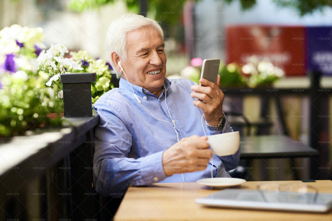 Senior Man Speaking By Video Call...: Stock Photos
