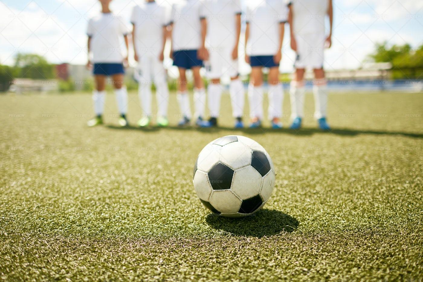 Ball On Grass In Football Field: Stock Photos