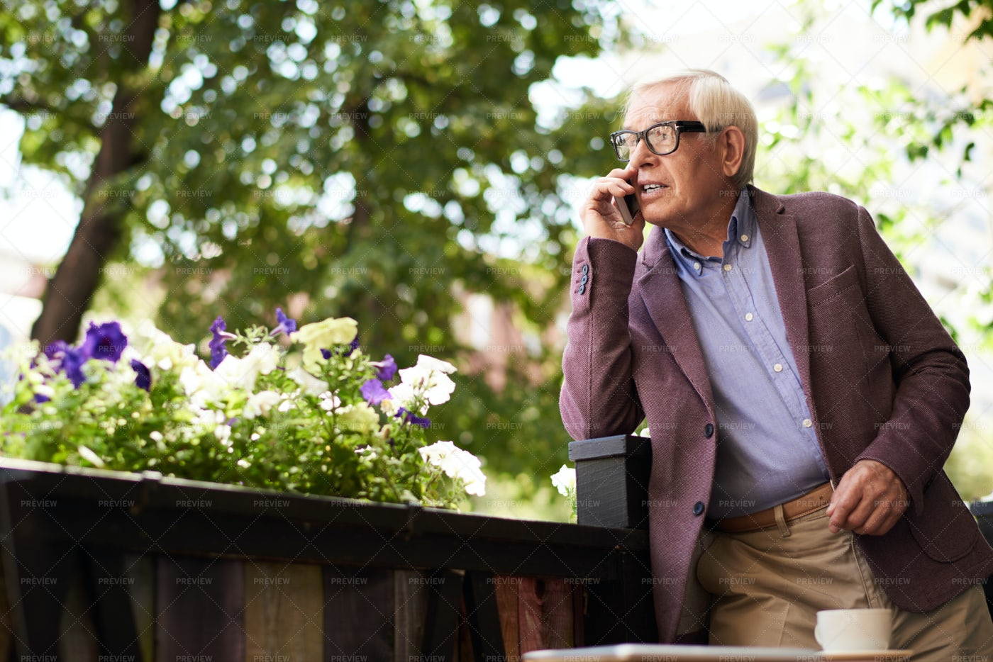 Senior Man Speaking By Phone...: Stock Photos