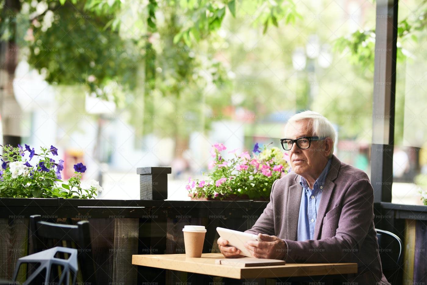 Pensive Senior Man In Cafe Outdoors: Stock Photos