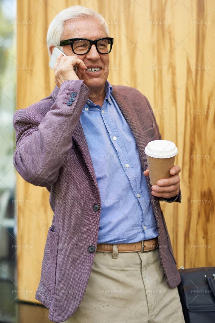 Contemporary Senior Man Speaking By...: Stock Photos