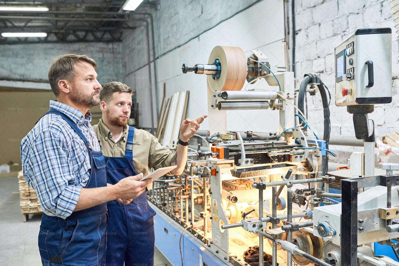 Workers Using Modern Machines At...: Stock Photos