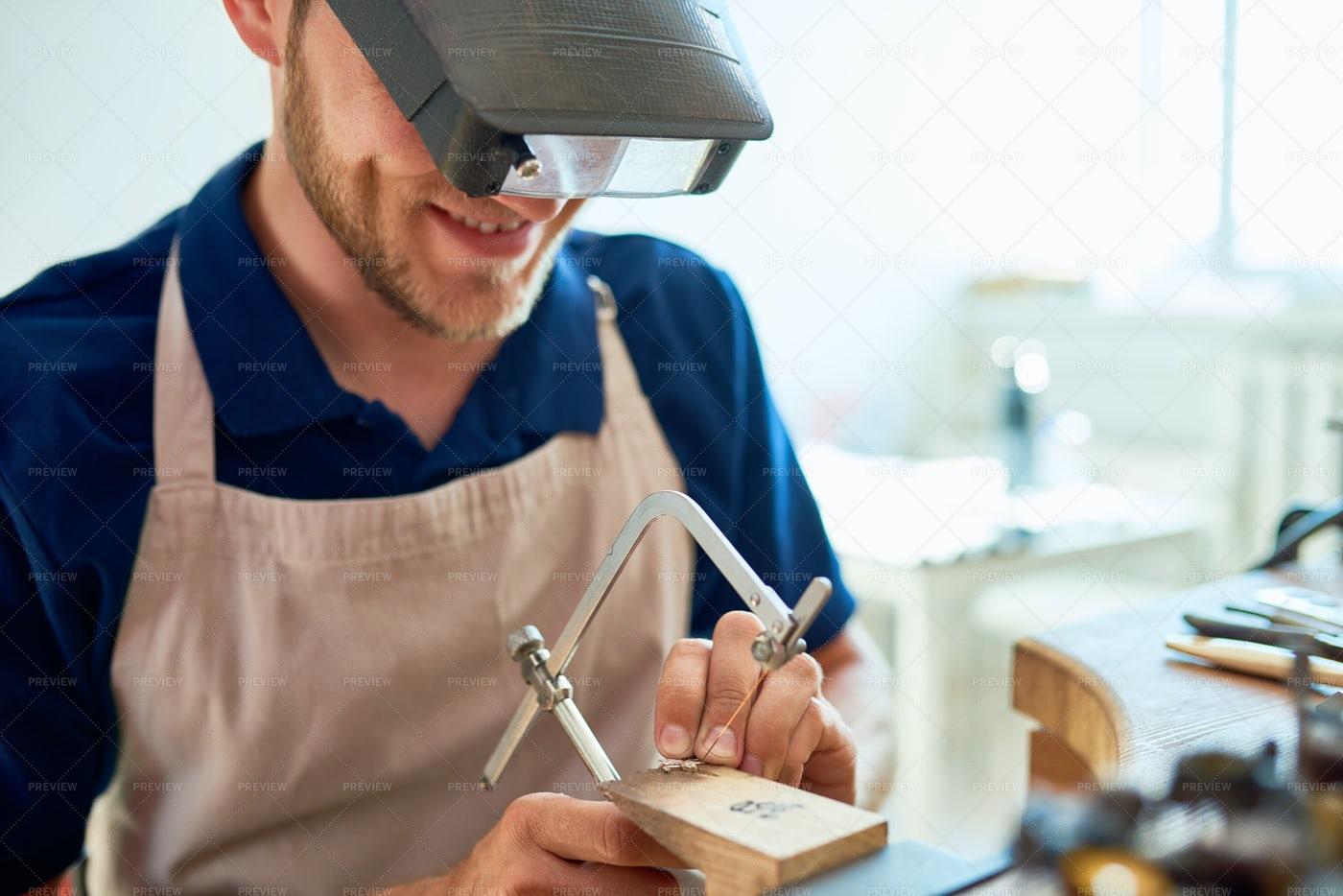 Smiling Craftsman Making Rings In...: Stock Photos