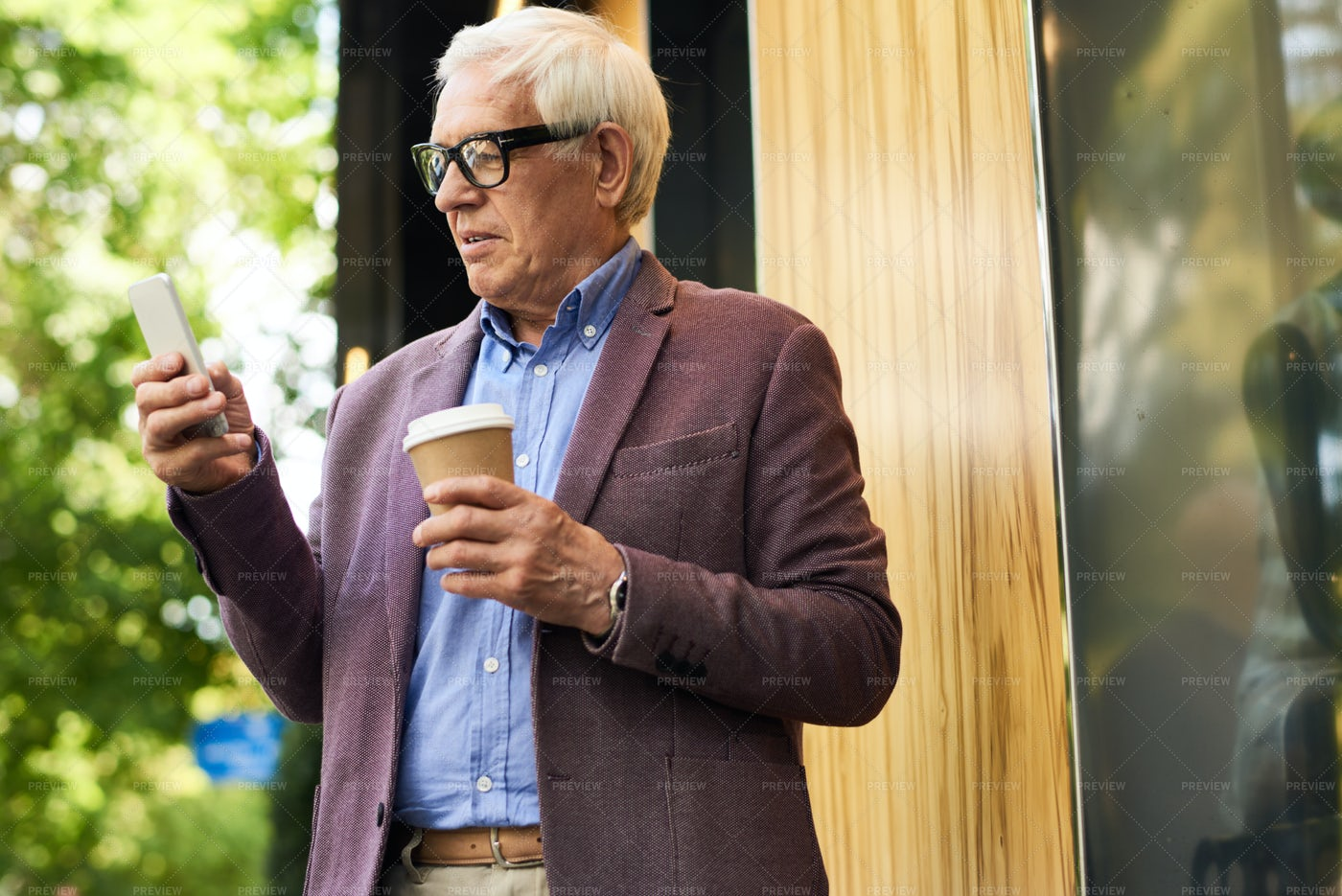 Modern  Senior Man With Smartphone: Stock Photos