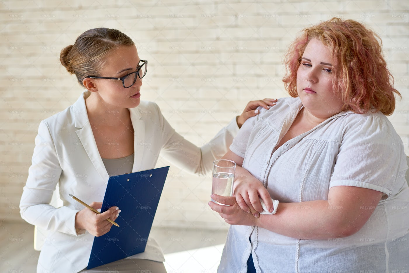 Female Psychiatrist Comforting...: Stock Photos