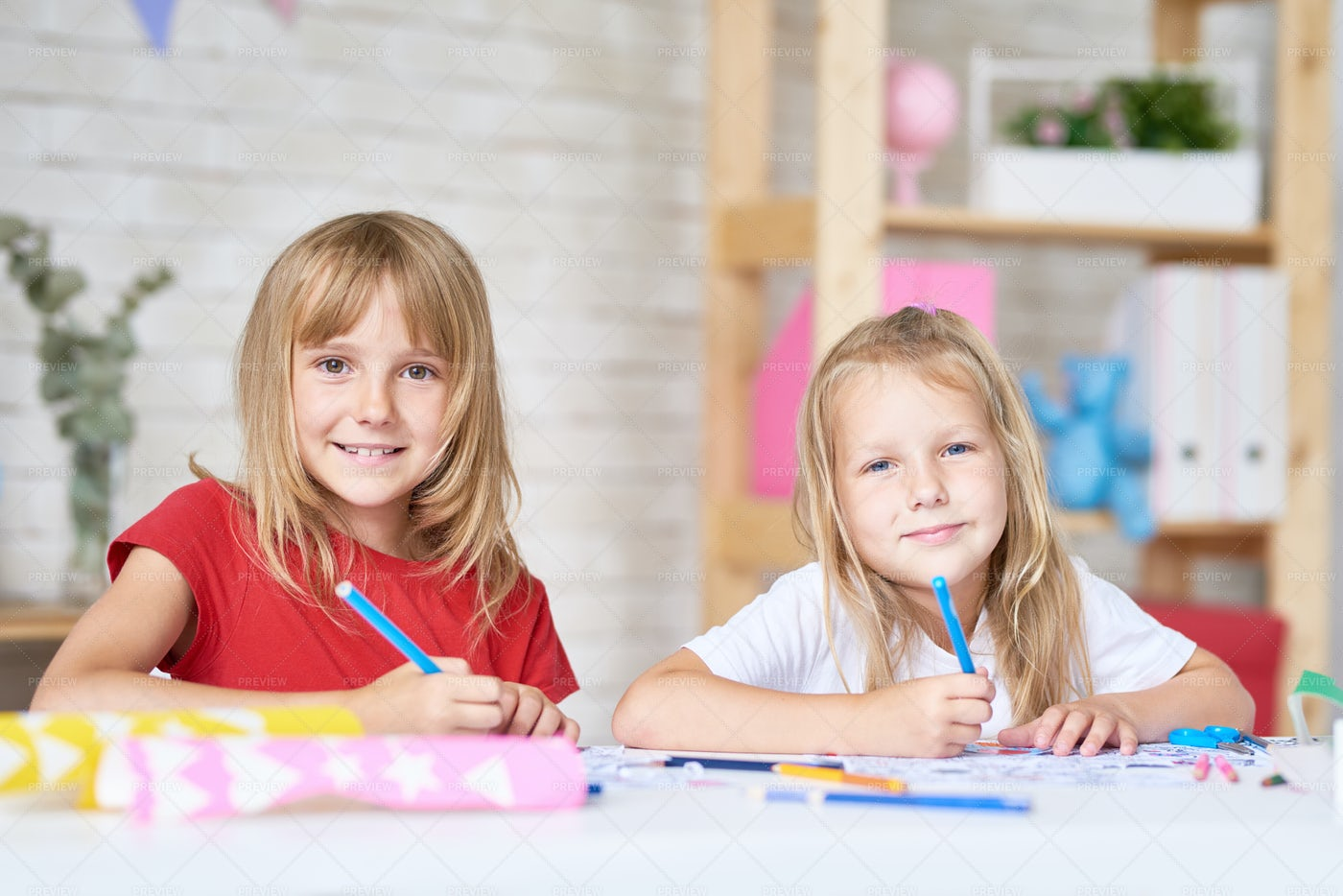 Portrait Of Creative Little Sisters: Stock Photos