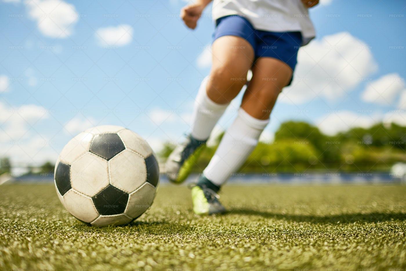 Boy Kicking Ball: Stock Photos