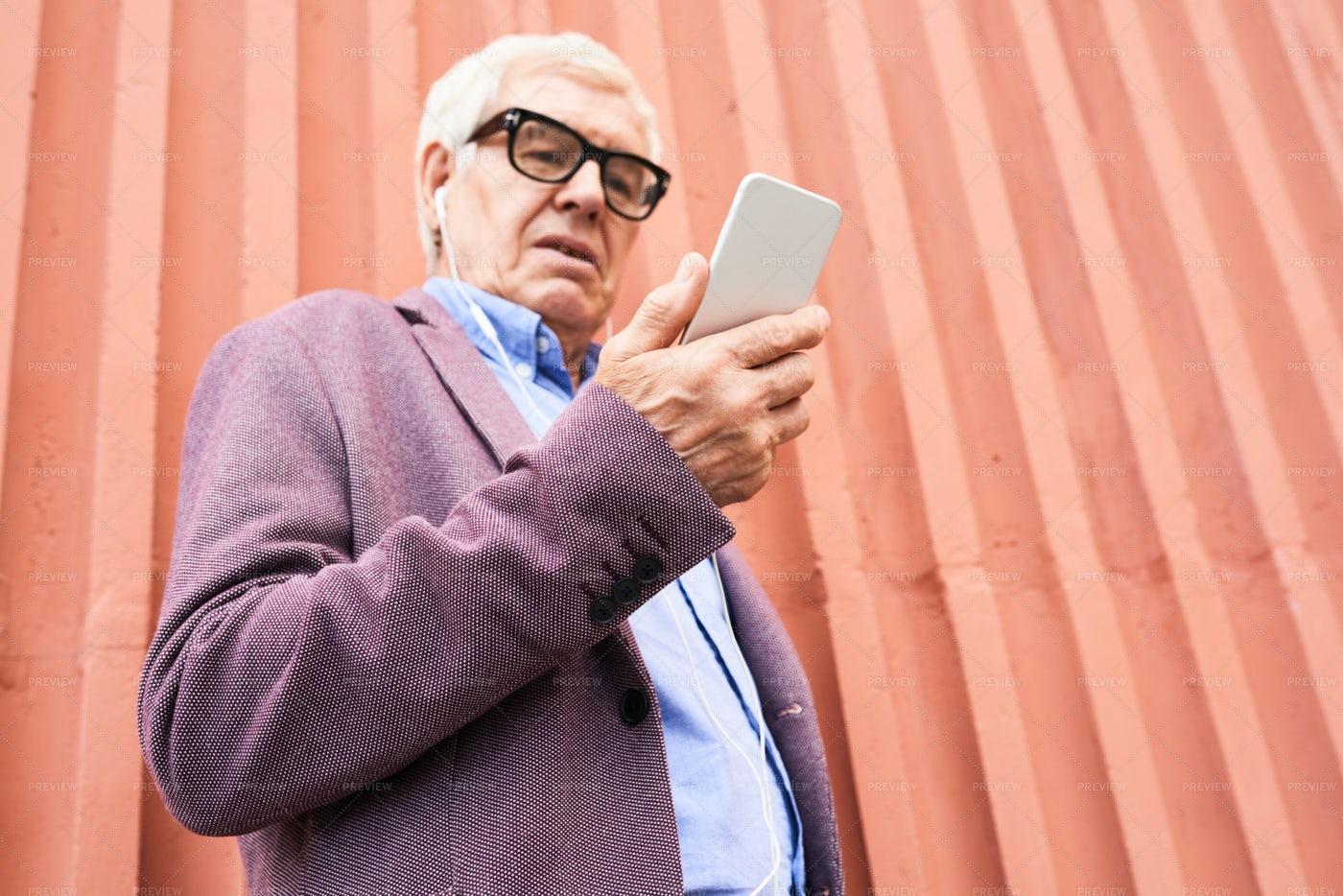 Trendy Senior Man Holding...: Stock Photos