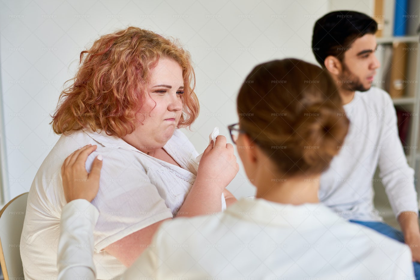 Obese Young Woman Crying In Support...: Stock Photos