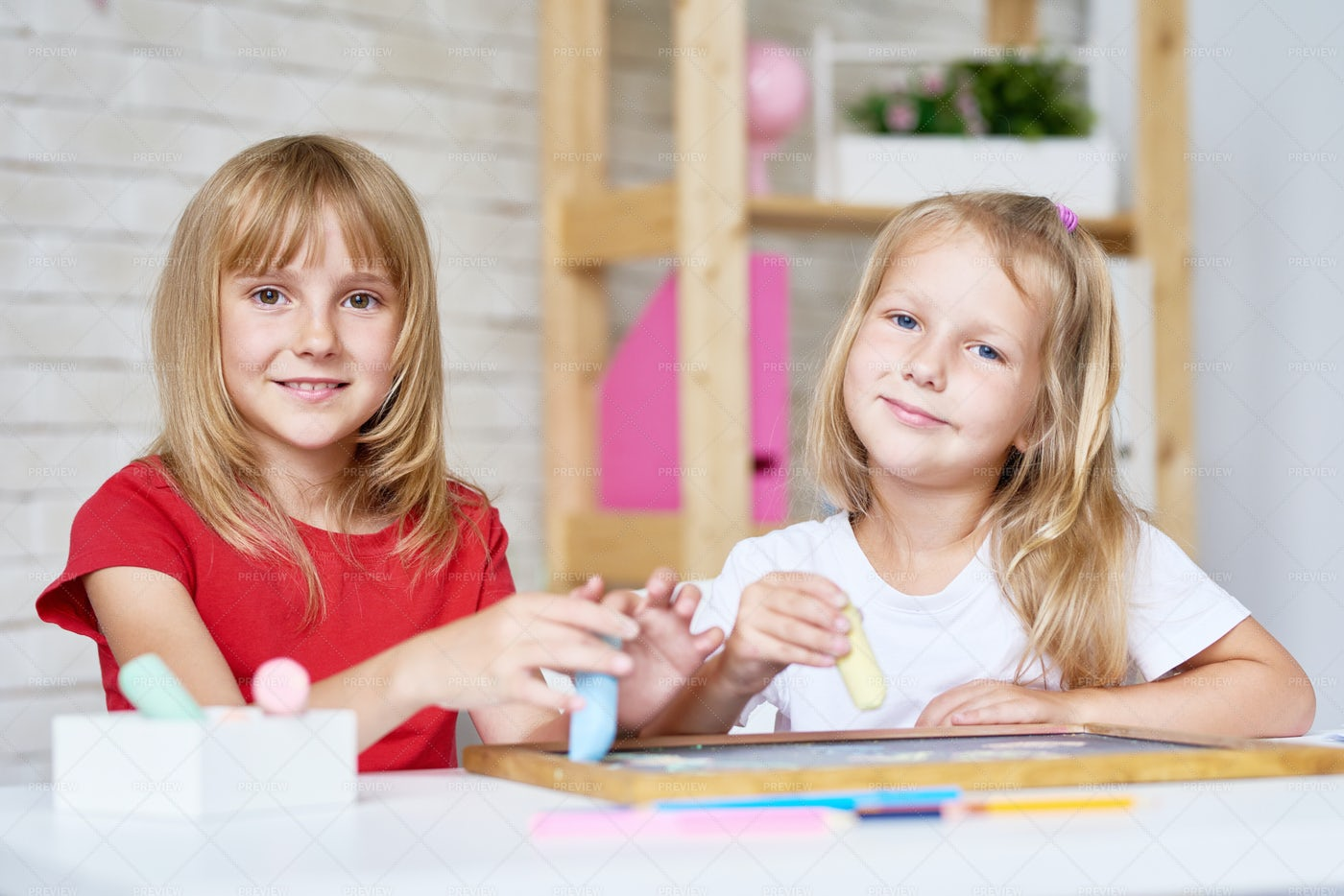 Cute Sisters Playing With...: Stock Photos