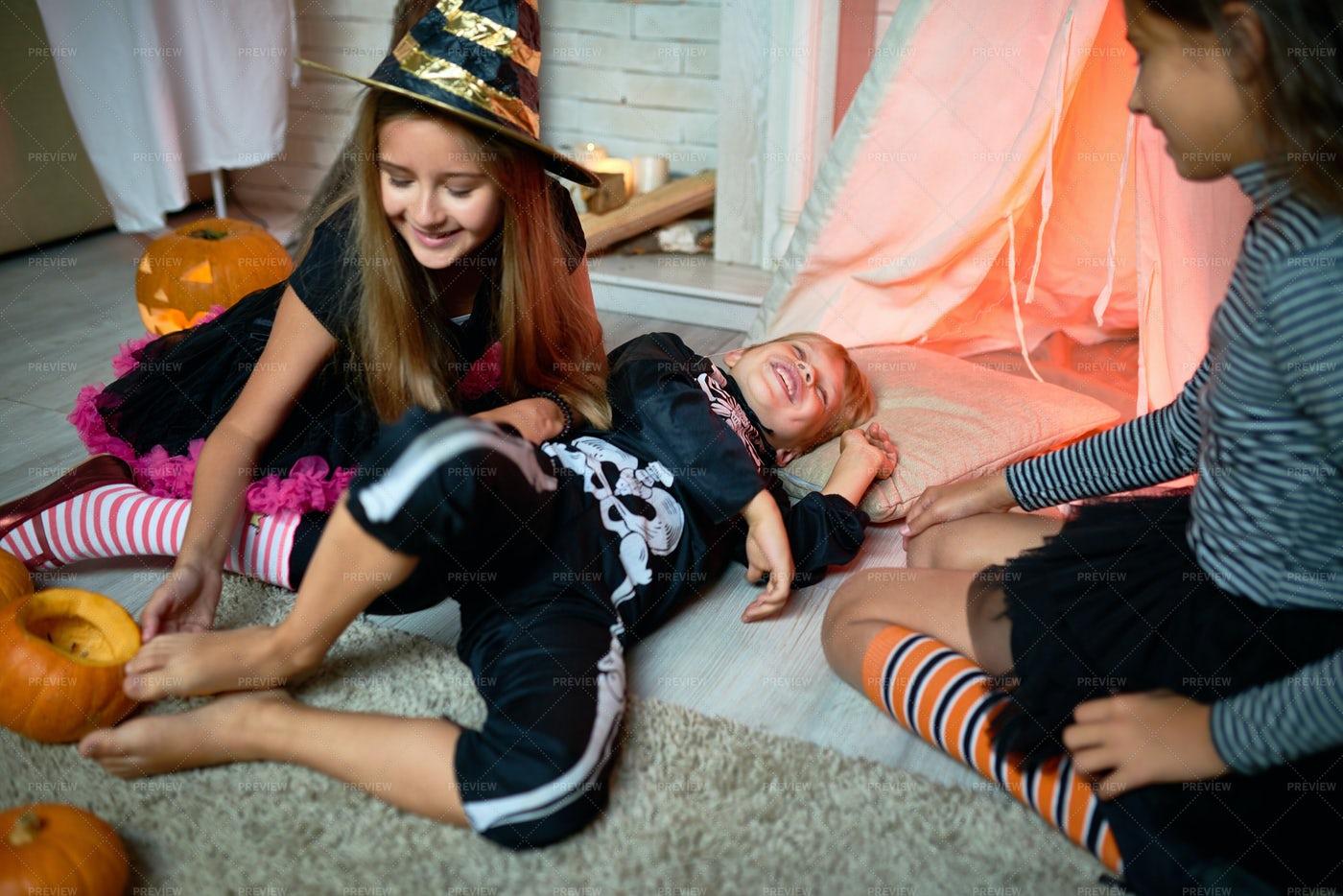 Jolly Girl Tickling Foot Of Friend: Stock Photos