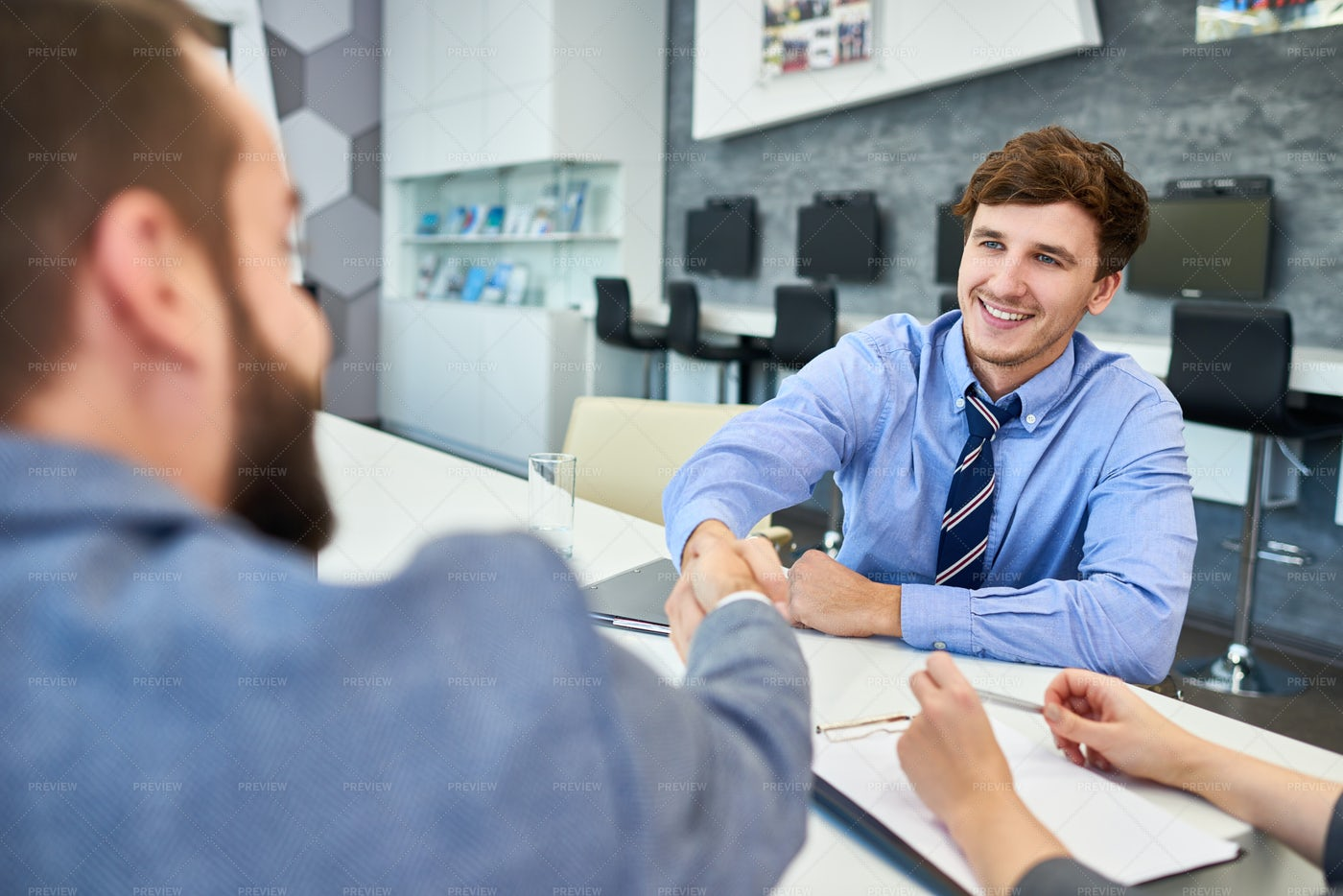 Greeting Business Partner With...: Stock Photos