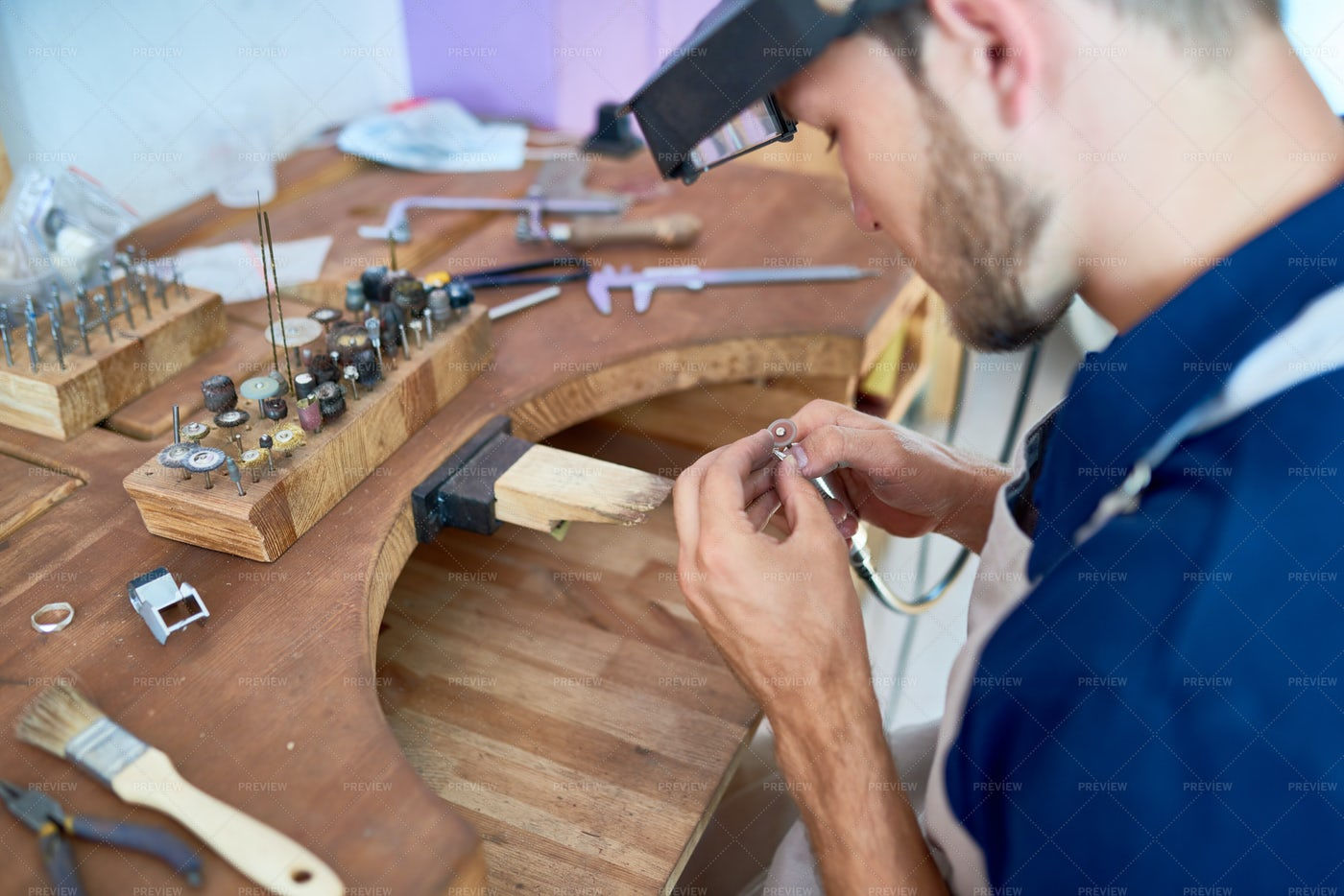 Craftsman Making  Jewelry In...: Stock Photos