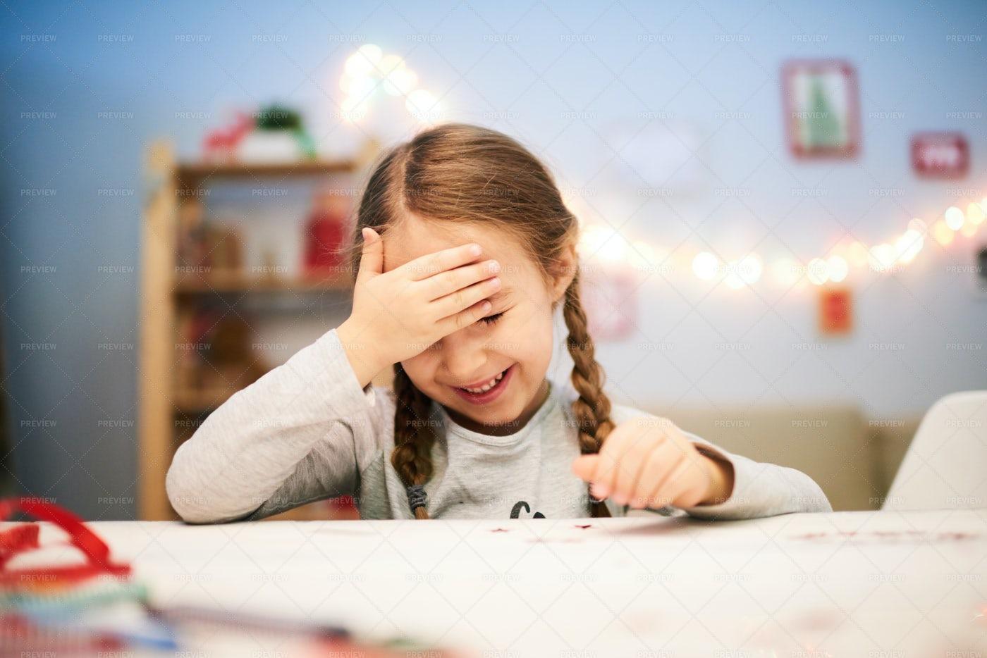 Little Girl Making Christmas Card: Stock Photos
