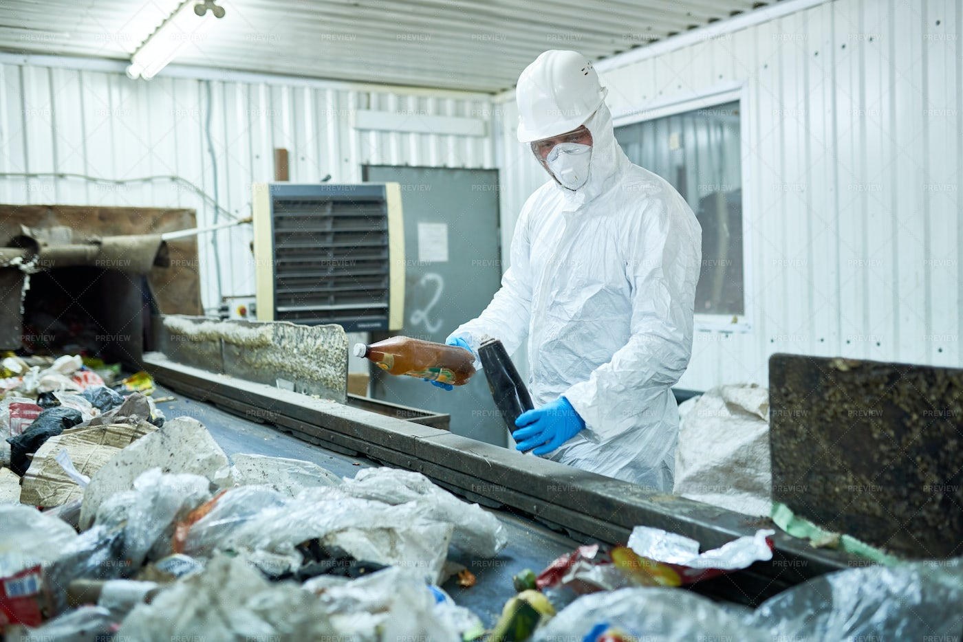 Worker Sorting Trash On Waste...: Stock Photos