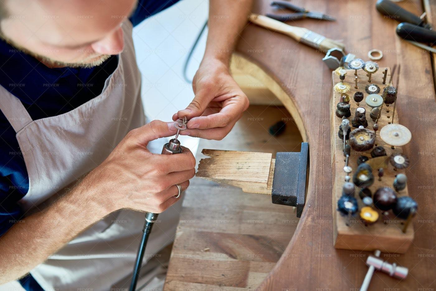 Artisan Making Jewelry In Workshop: Stock Photos