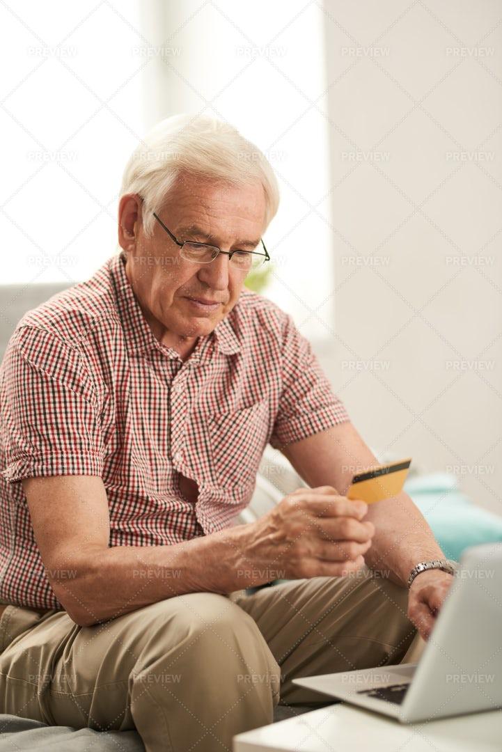 Senior Man Shopping Online At Home: Stock Photos