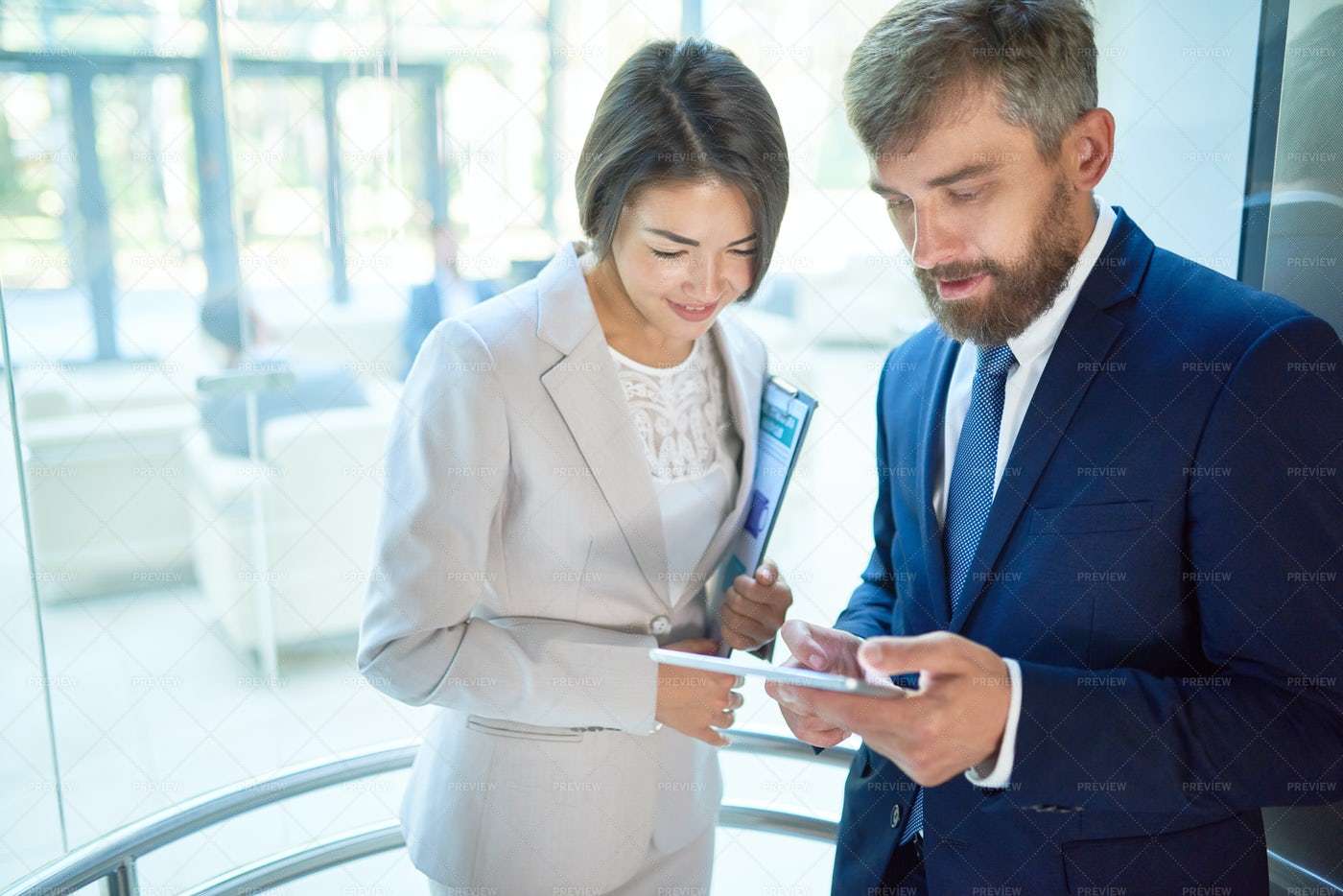 Business People In Glass Elevator: Stock Photos