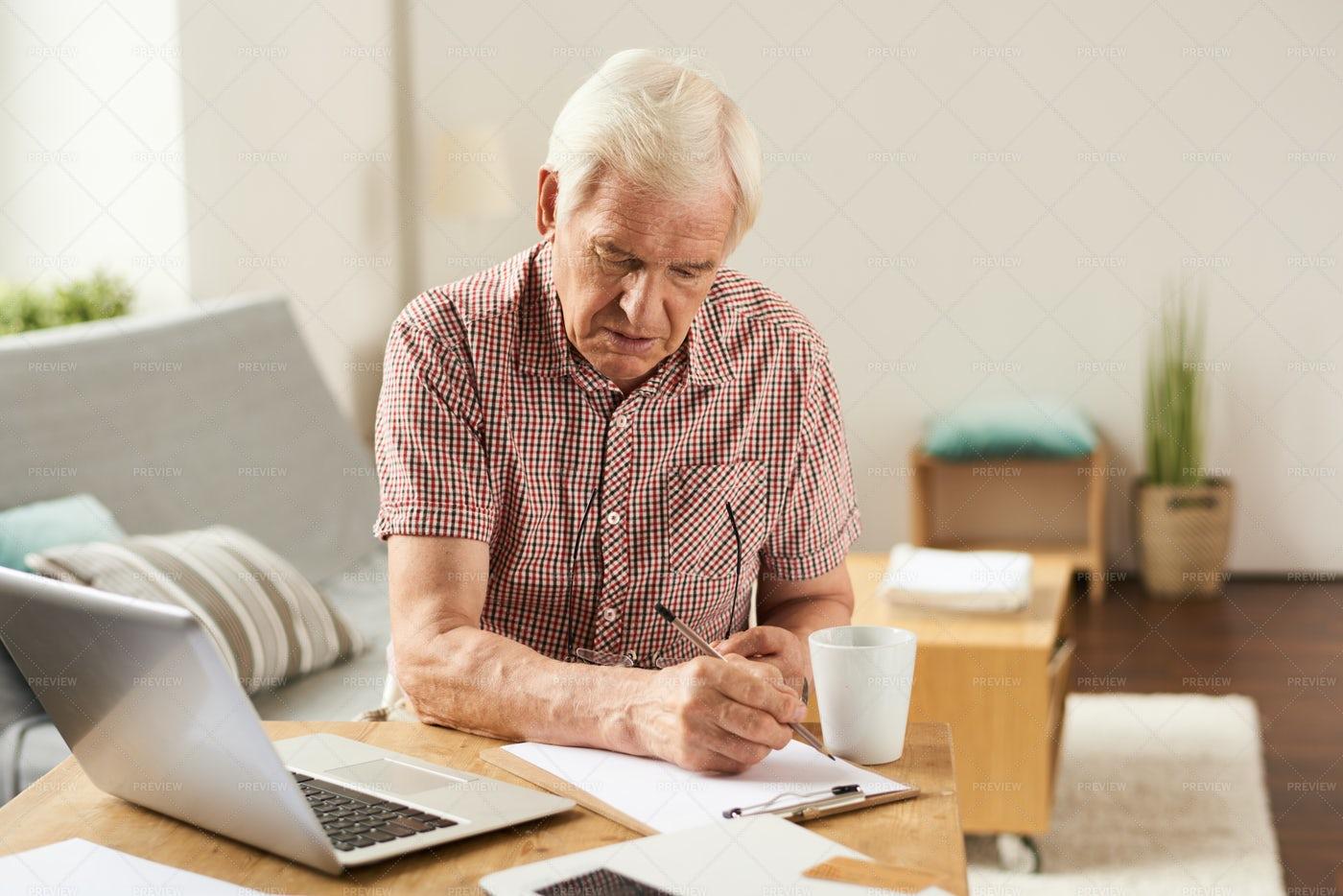 Senior Man Counting Budget At Home: Stock Photos