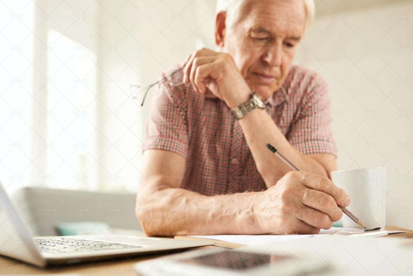Senior Man Writing At Home: Stock Photos