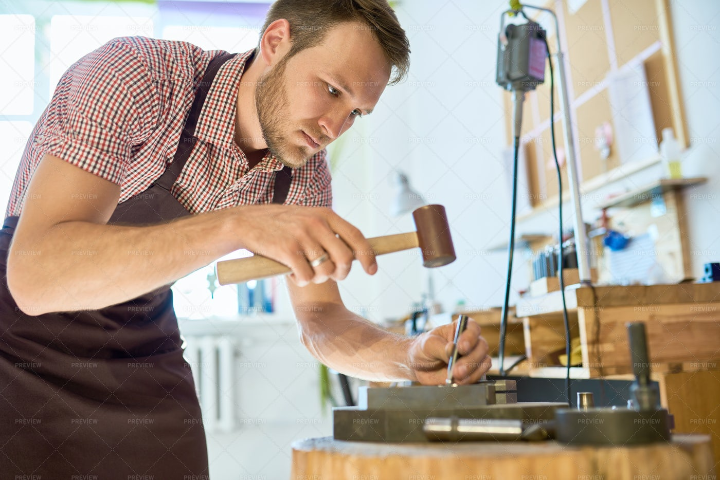 Man Doing Metalwork In Small Studio: Stock Photos
