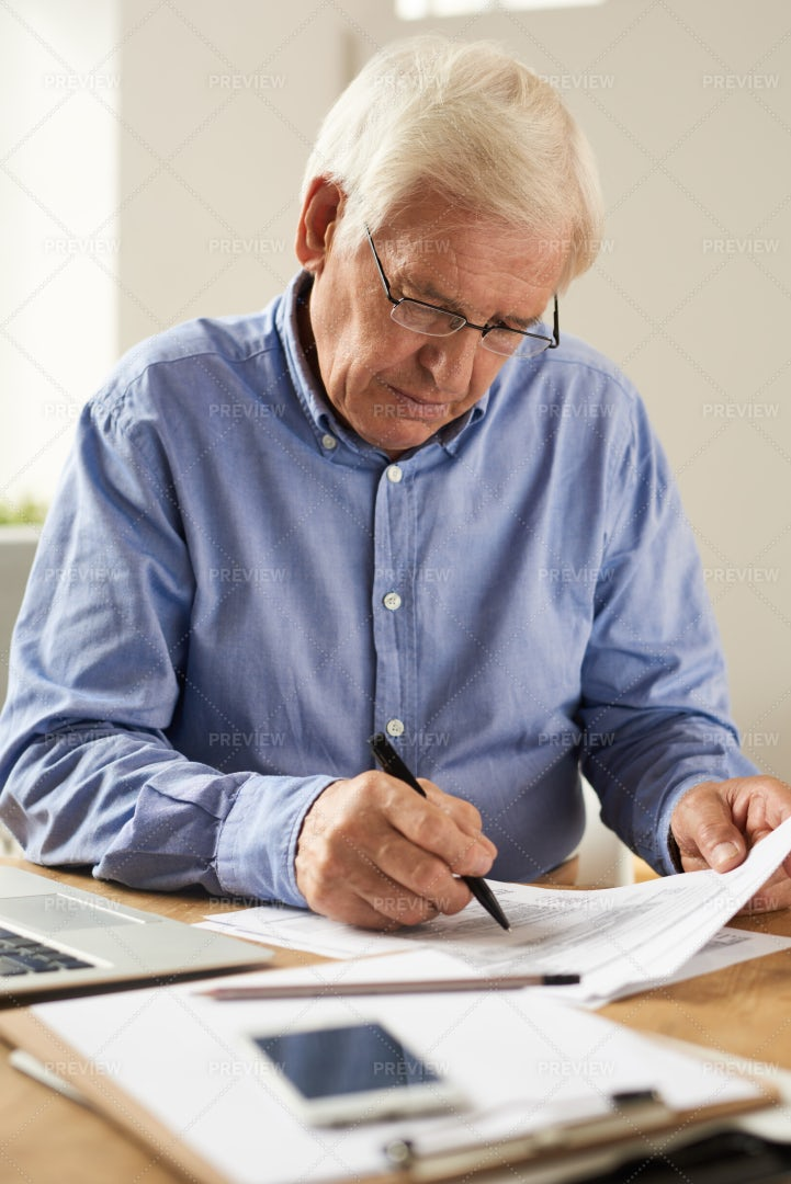 Senior Man Writing Tax Report: Stock Photos