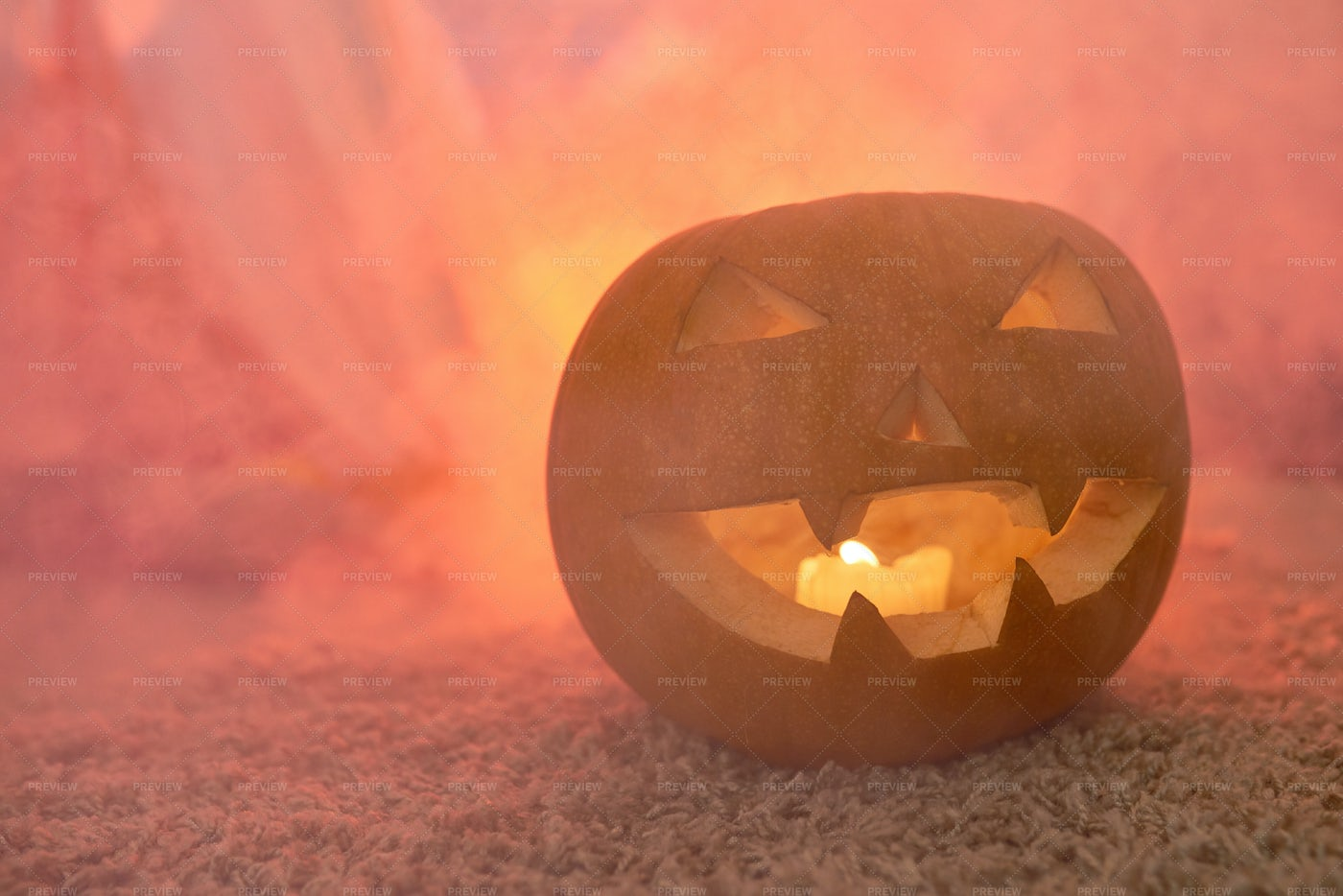 Scary Carved Pumpkin In Smoke: Stock Photos
