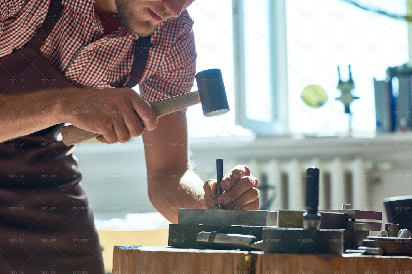 Man Working With Metal In Small...: Stock Photos
